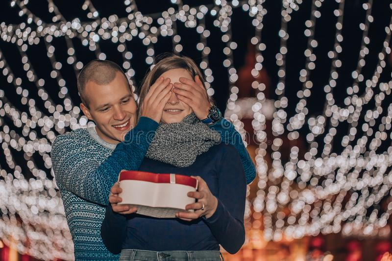 Man keeps his girlfriend eyes covered while she giving a gift royalty free stock photos