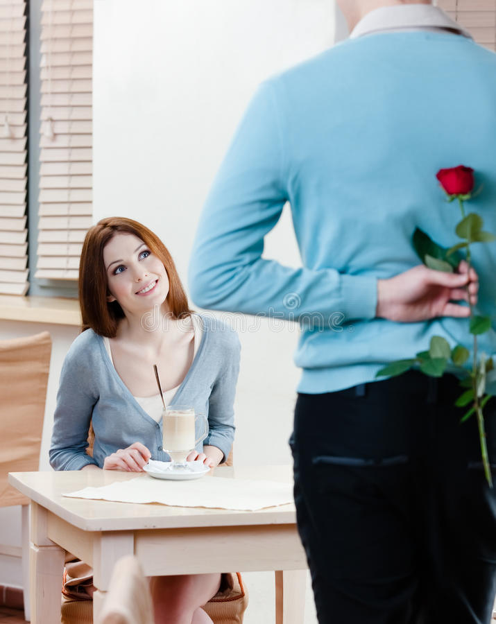 Download Man Keeps Red Rose Behind His Back Stock Photo - Image of hair, girl: 26547900