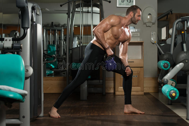 Man And Kettle Bell. Athletic Man Workout With Kettle Bell stock photography