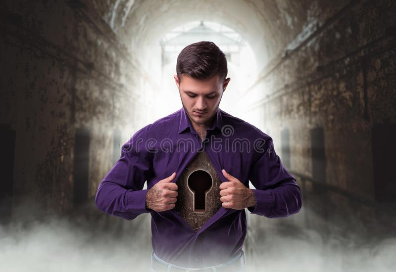 Man with keyhole in chest, lock from the heart. Abandoned house on background royalty free stock photography