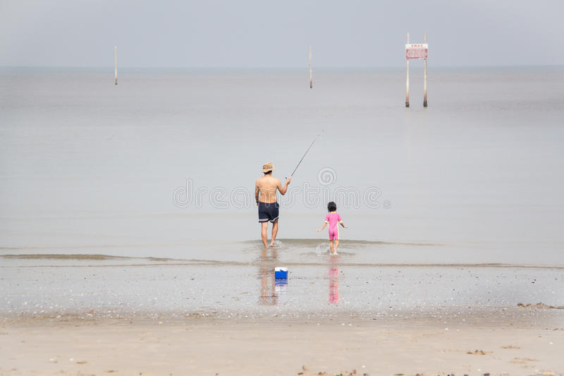Download Man And Kid Walking Towards The Sea To Fish Royalty Free Stock Images - Image: 34805099
