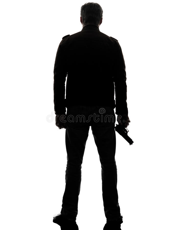 Man killer policeman holding gun walking silhouette stock photos