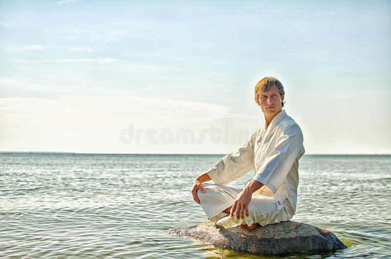 Download Man in kimono meditating stock photo. Image of activity - 25993752