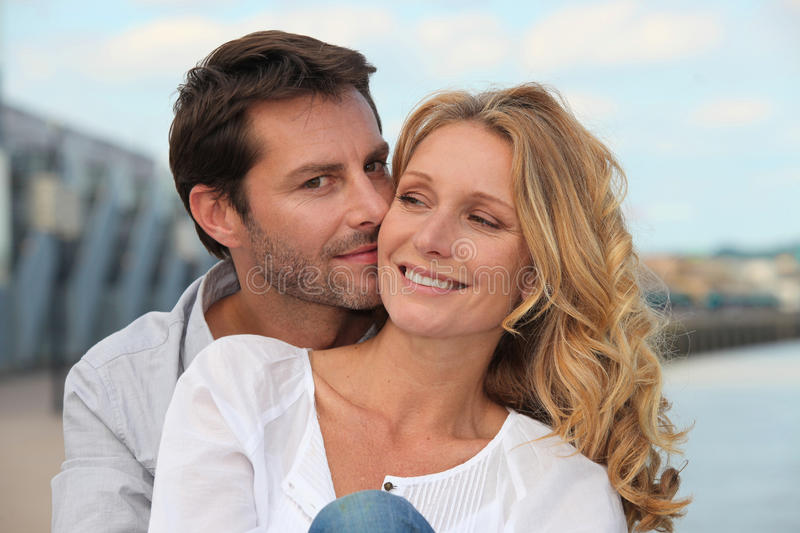 Man kissing his partner stock images