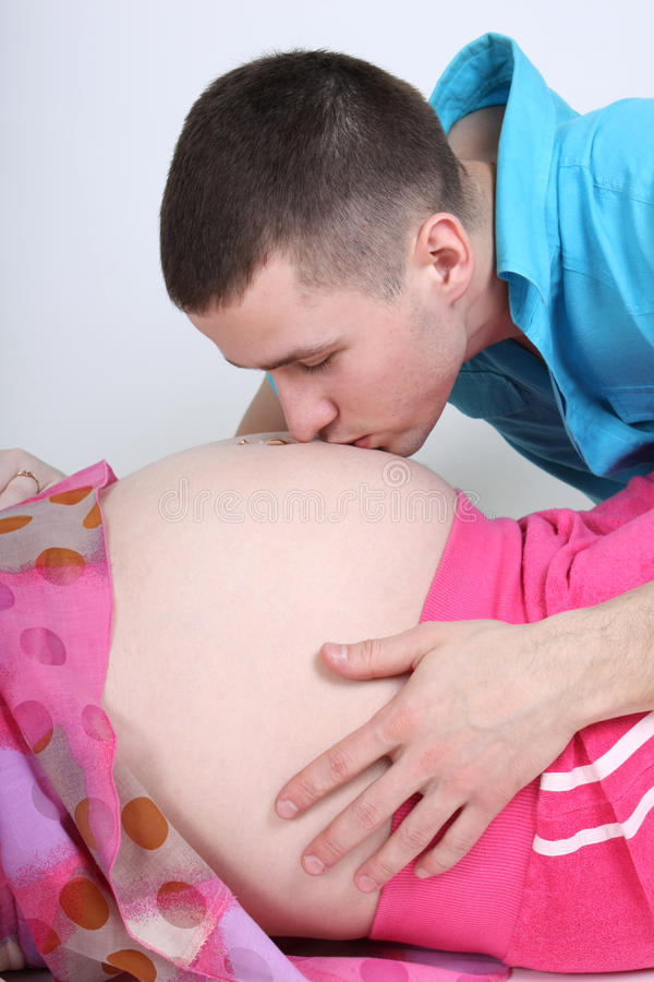 Man Kissing To His Pregnant Wife S Stock Photography