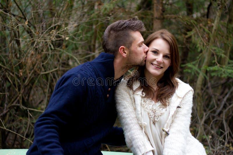 Man kissing woman on the cheek