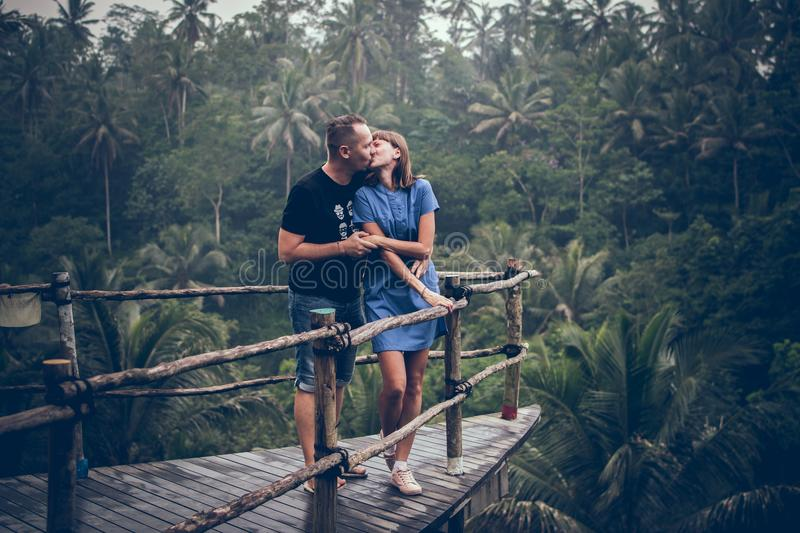 Man Kissing Woman on Cliff stock image