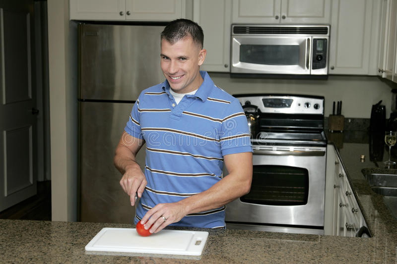 Man in the kitchen royalty free stock photos