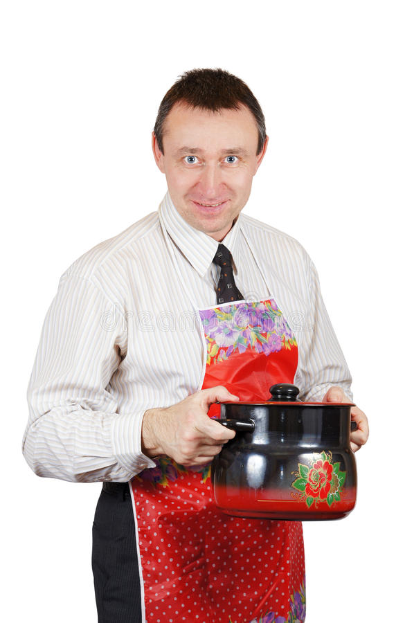 Download Man In A Kitchen Apron Holds A Pan Stock Image - Image: 24131785
