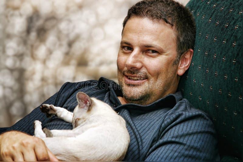 Man and kitten royalty free stock image