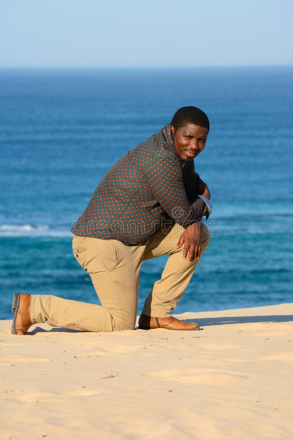 Download Man kneeling on beach stock photo. Image of sunny, smiles - 32738994