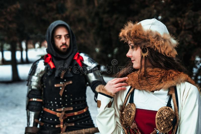 Man knight in armor and woman in historical costume stock images