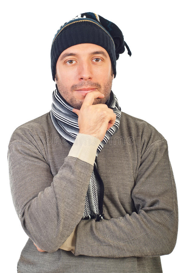 Man with knit cap thinking stock photo
