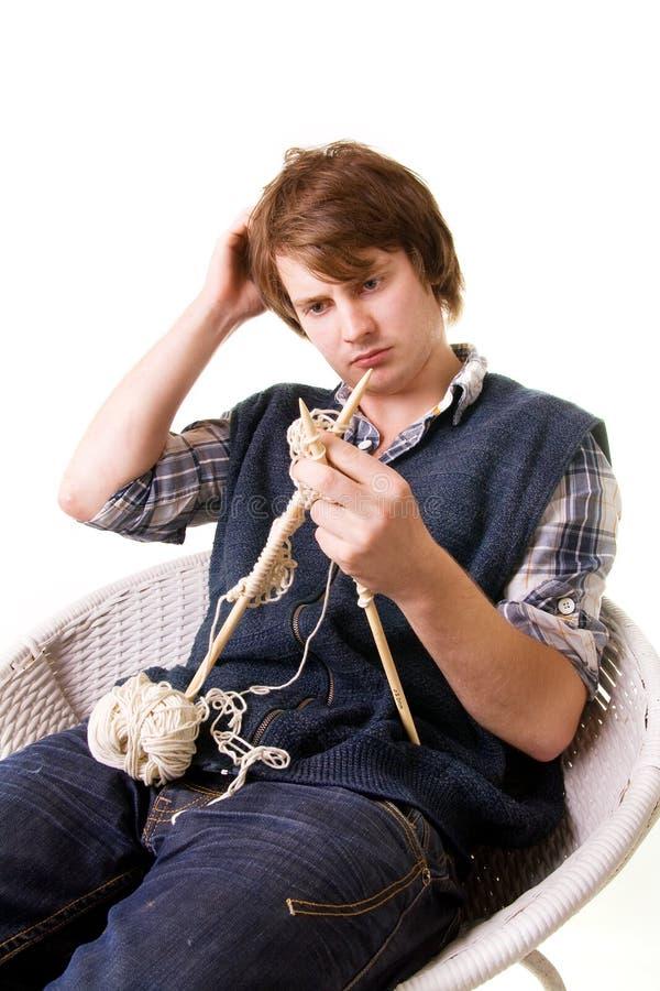 Man knitting art craft stock photo