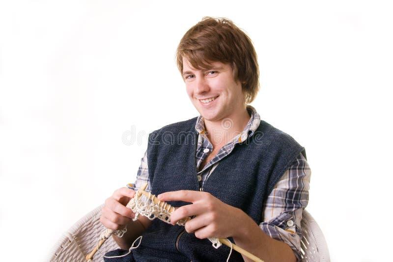 Man knitting art craft stock image