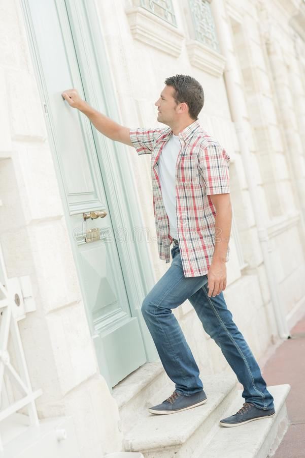 Man knocking at door arrive. Man knocking at a door arrive royalty free stock photos