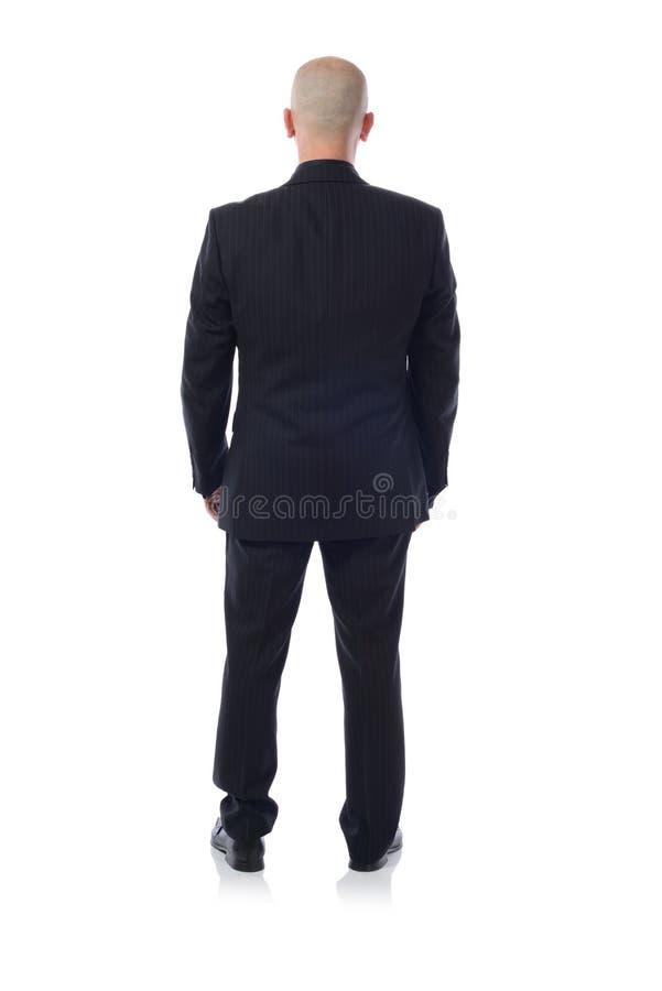 #Man in kostuum van erachter royalty-vrije stock fotografie