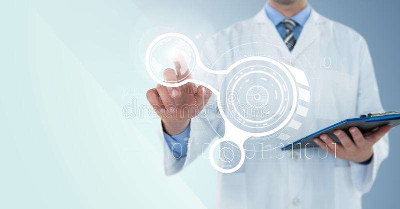 Man in lab coat with clipboard pointing at white interface and flare against blue background royalty free stock photography
