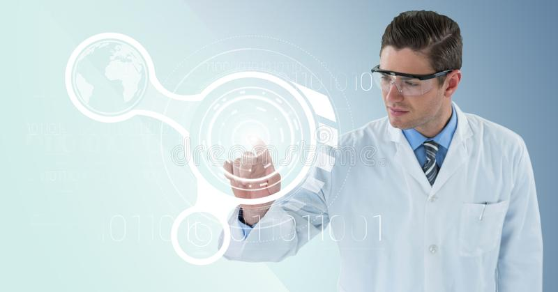 Man in lab coat and goggles pointing at white interface and flare against blue background stock photos