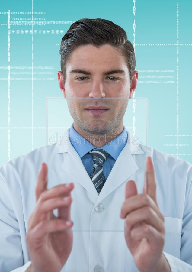 Man in lab coat holding up glass device against white interface and blue background stock photography
