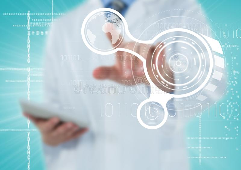 Man in lab coat pointing at white interface against blue background stock photo