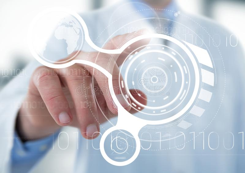 Man in lab coat pointing at white interface with flare against blurry background royalty free stock images