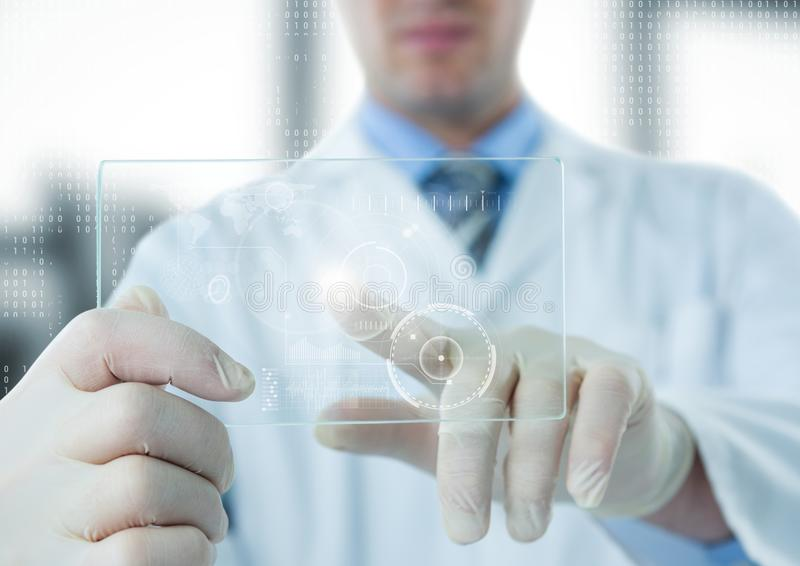 Man in lab coat pointing at white interface and flare on glass device against blurry window royalty free stock photos