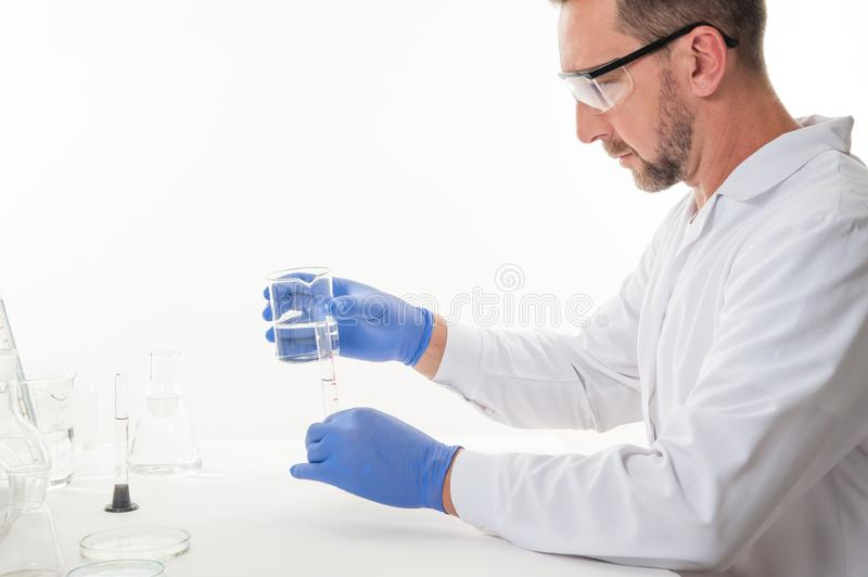 View of a man in the laboratory while performing experiments. Man in the laboratory, view of a man in the laboratory while performing experiments royalty free stock photography