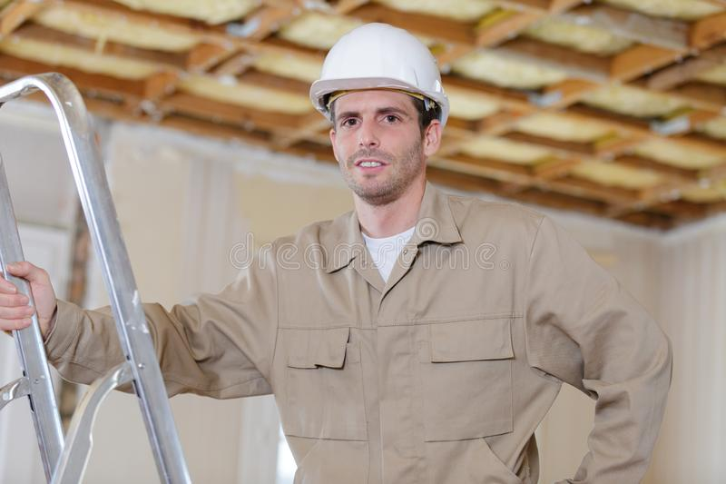 Man on ladder stock photography