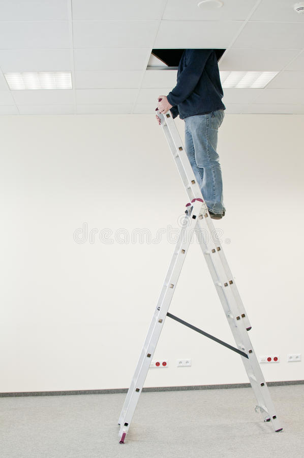Man on the ladder stock image