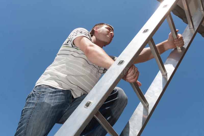 Man on the ladder stock photos