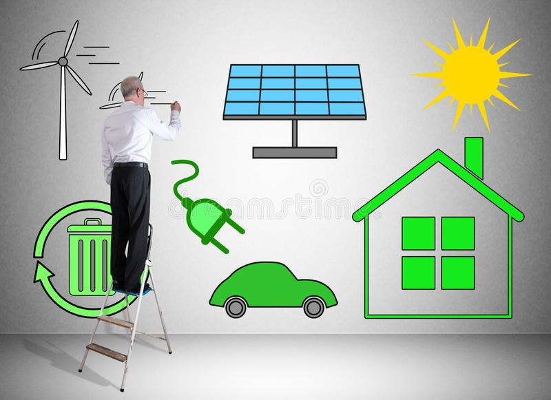 Clean energy concept drawn by a man on a ladder stock images