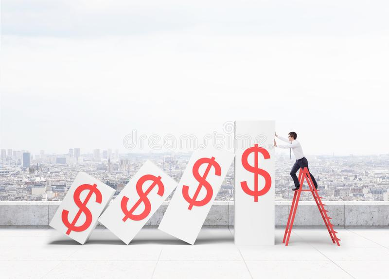 Man on ladder holding declining dollar graph royalty free stock images
