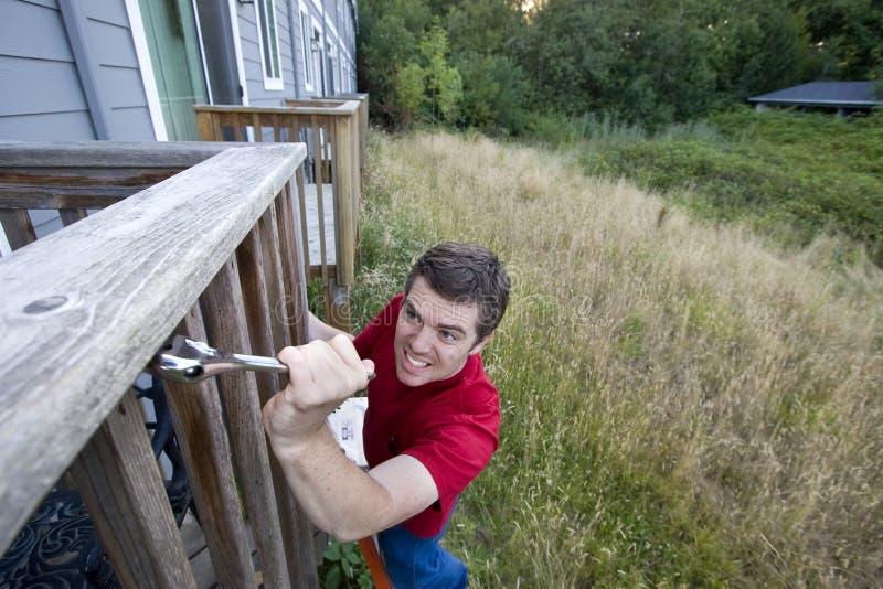 Man on Ladder - Horizontal royalty free stock photos