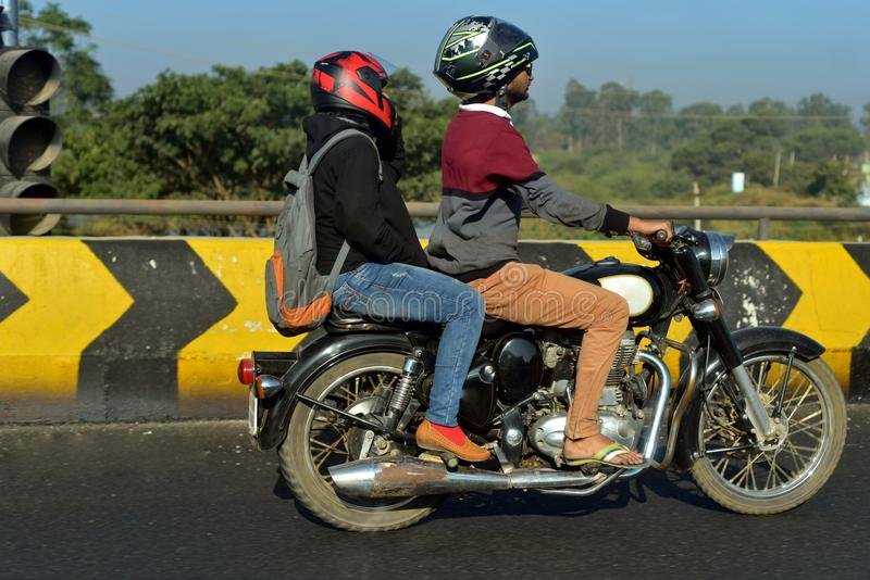 Indian bikers are biking on the road - stock photograph. A man and a lady both are riding a motorbike on the city streets of India stock photograph royalty free stock photography