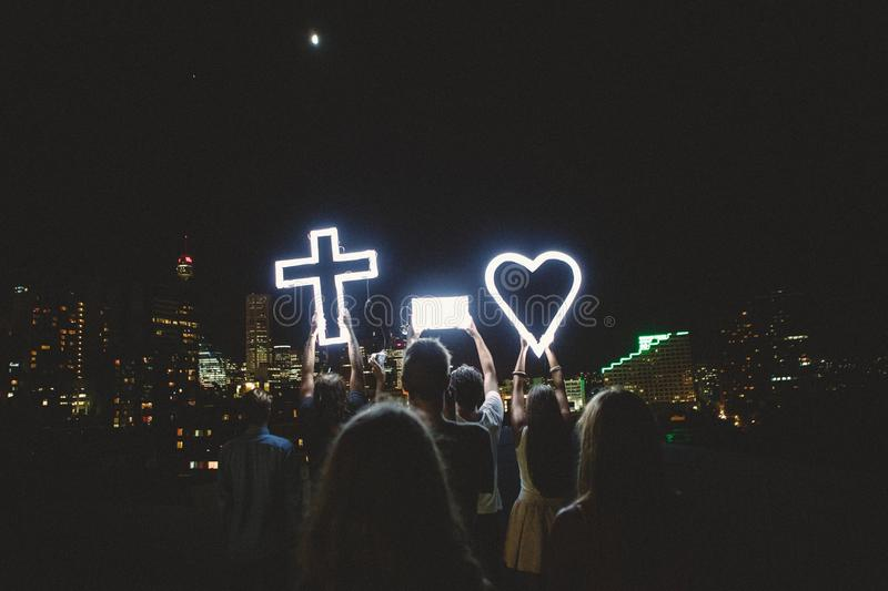 Man And Lady Raising Cross Heart Led Light Photo During Night Time Free Public Domain Cc0 Image