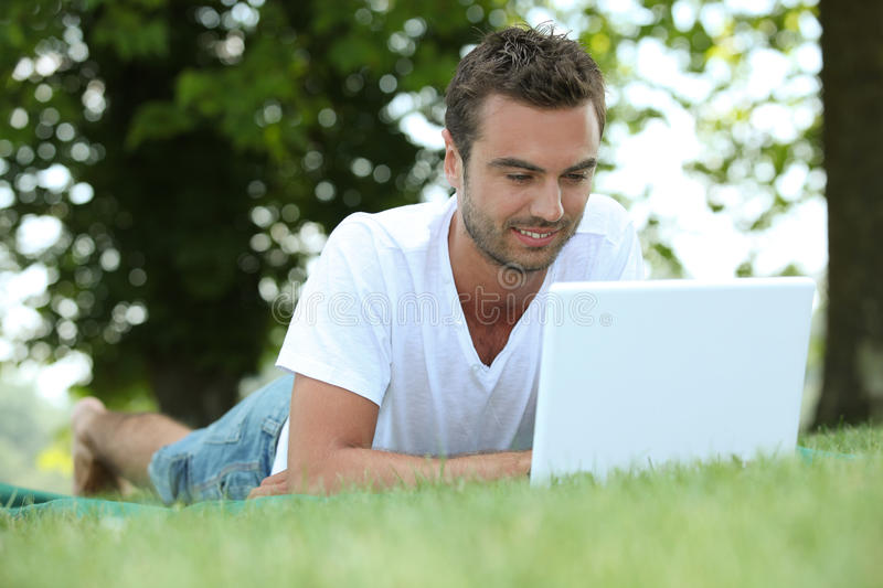 Download Man Laid In Field Royalty Free Stock Images - Image: 25357719