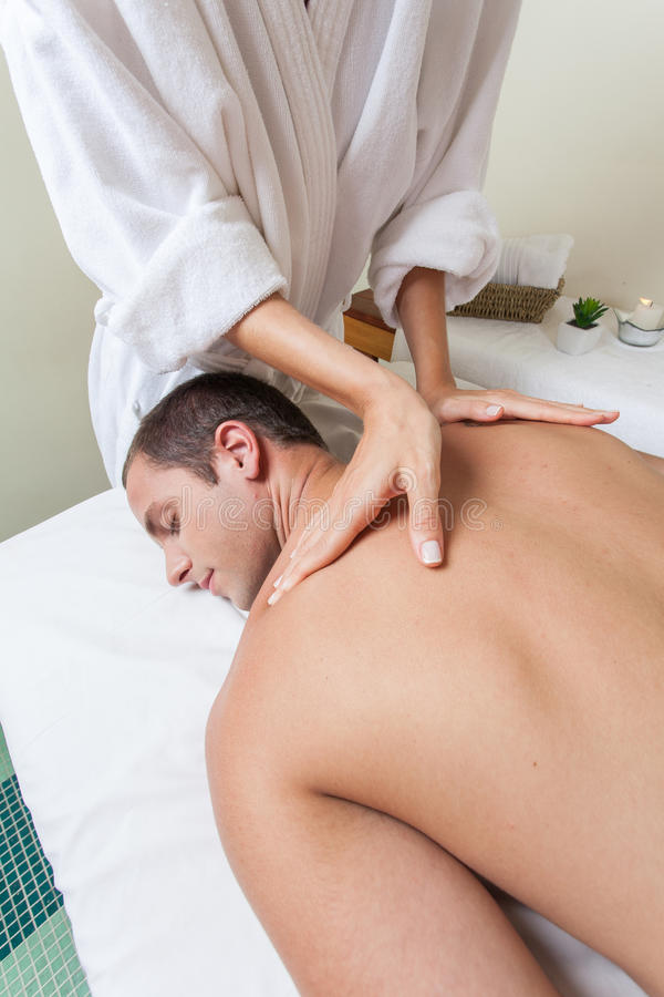 Man laid receiving massage stock image