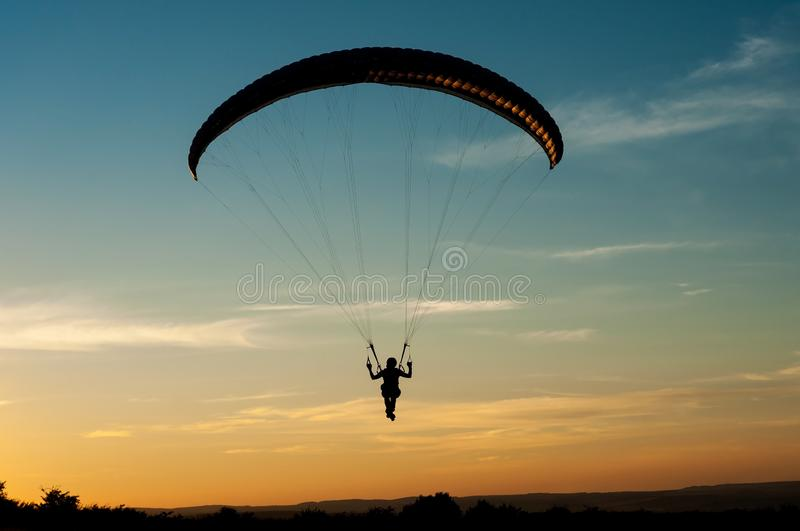 A man lands on a paraglider royalty free stock photography