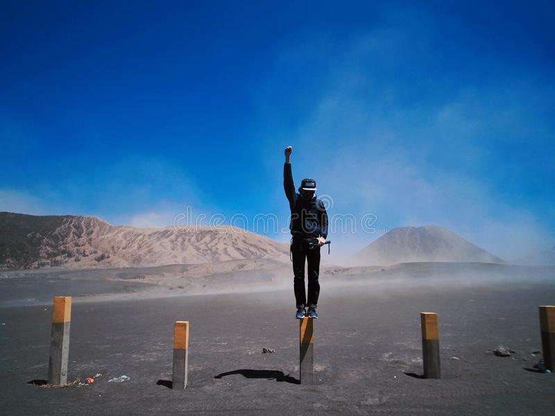 Man landscape volcano blue sky royalty free stock photo