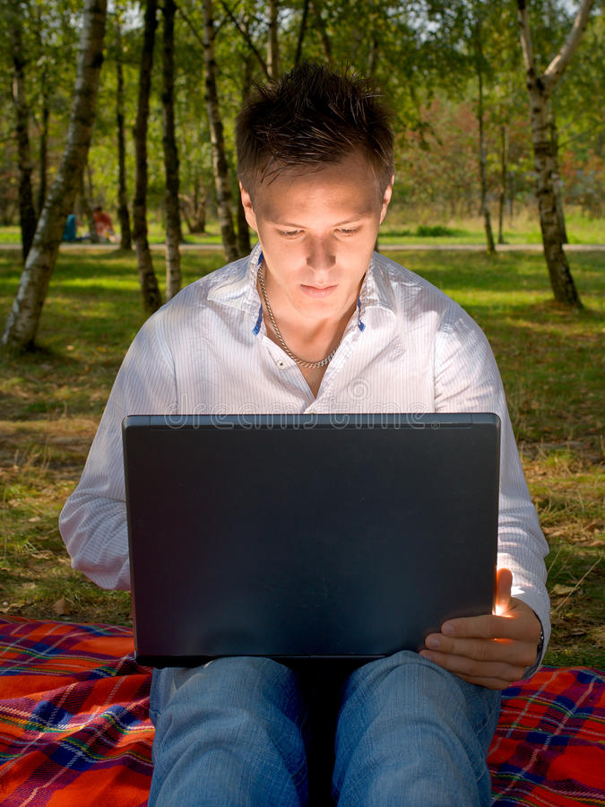 Man with a laptop stock images