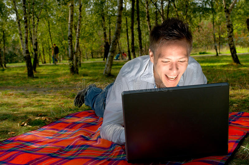 Man with a laptop stock photography