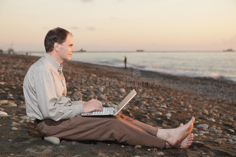 Download Man With Laptop On The Beach Stock Photo - Image: 13268096