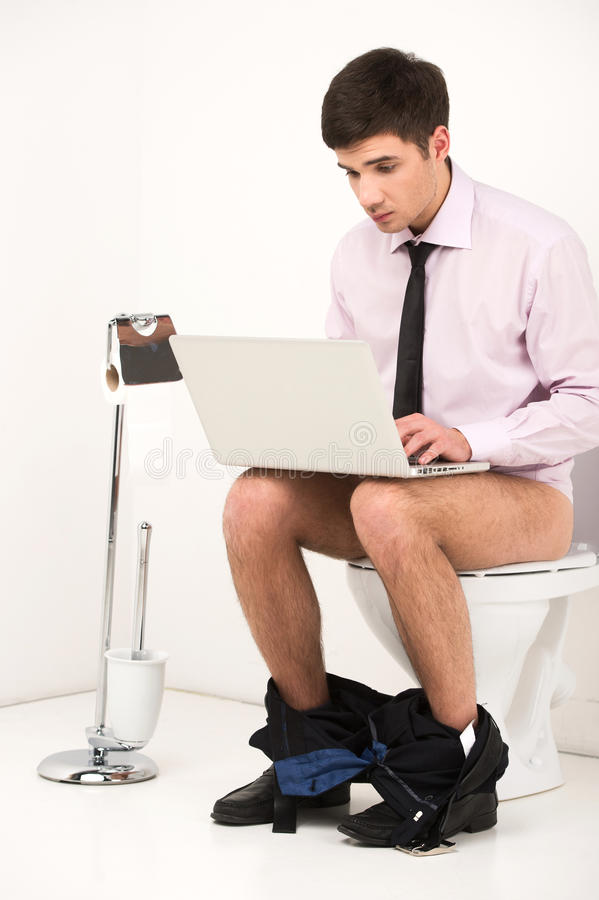 Man With Laptop Computer Sitting On Toilet Stock Image