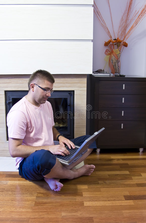 Download Man with laptop on floor stock image. Image of sits, laptop - 5824267