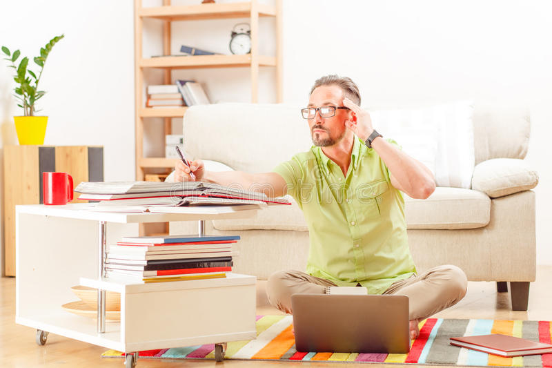 Man on laptop running business from home stock photo