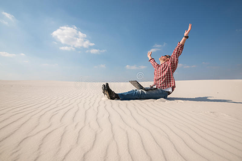 Man Laptop Sits Middle Desert Photos - Free & Royalty-Free Stock Photos from Dreamstime
