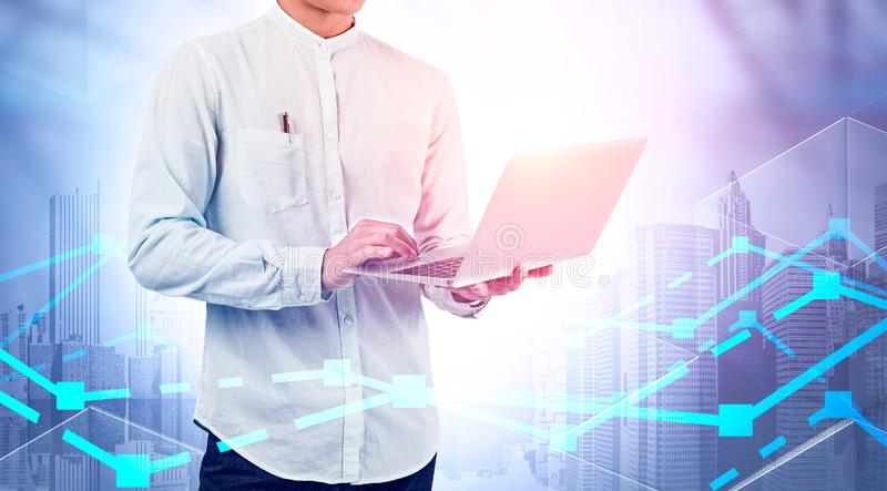 Man with laptop, stock market analysis royalty free stock images