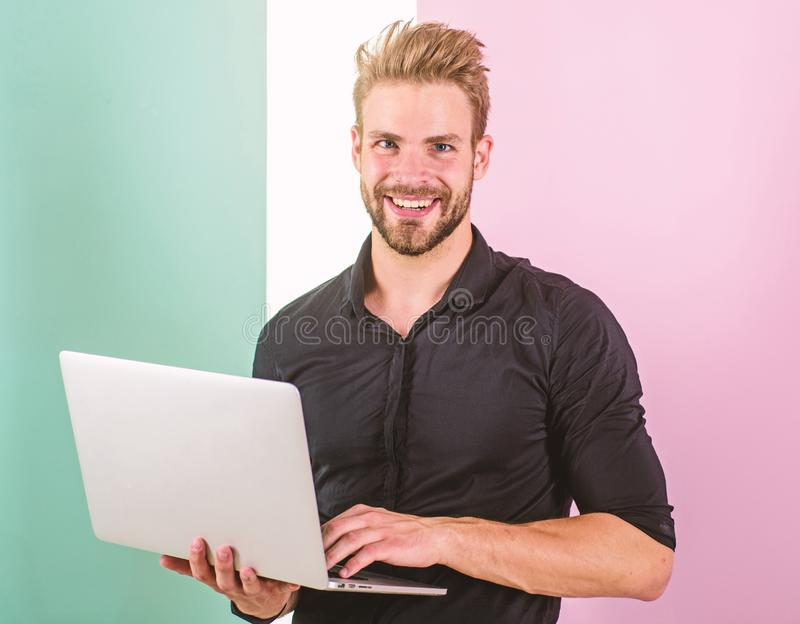 Man with laptop works as smm expert. Smm manager promotes brands and items on internet. Social media marketing expert. Guy stylish modern appearance manager royalty free stock photo