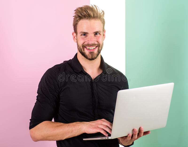 Man with laptop works as smm expert. Smm manager promotes brands and items on internet. Social media marketing expert. Guy stylish modern appearance manager stock image